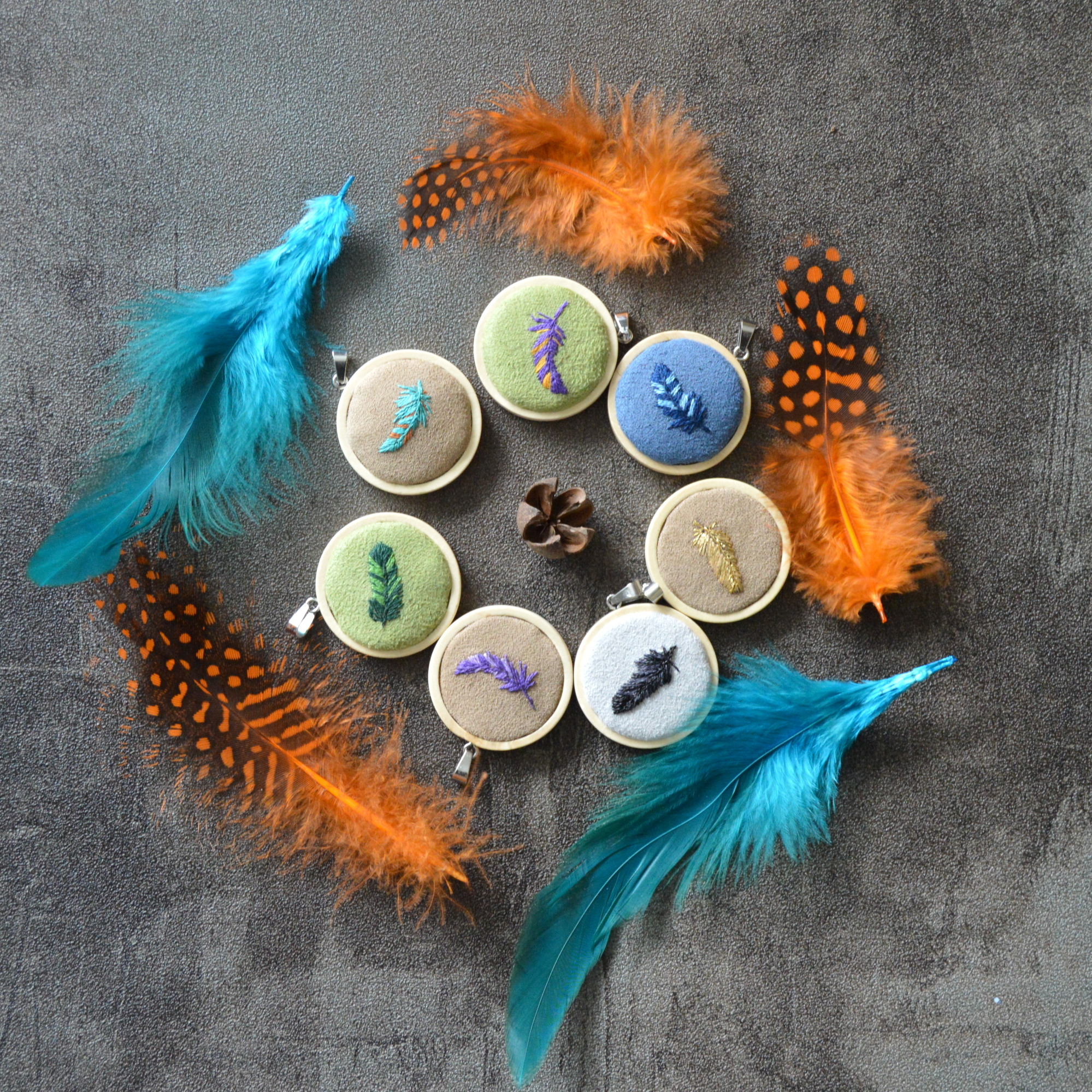 Embroidered feather necklaces
